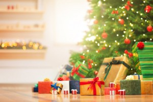 Christmas gifts under christmas tree in the sunny morning.